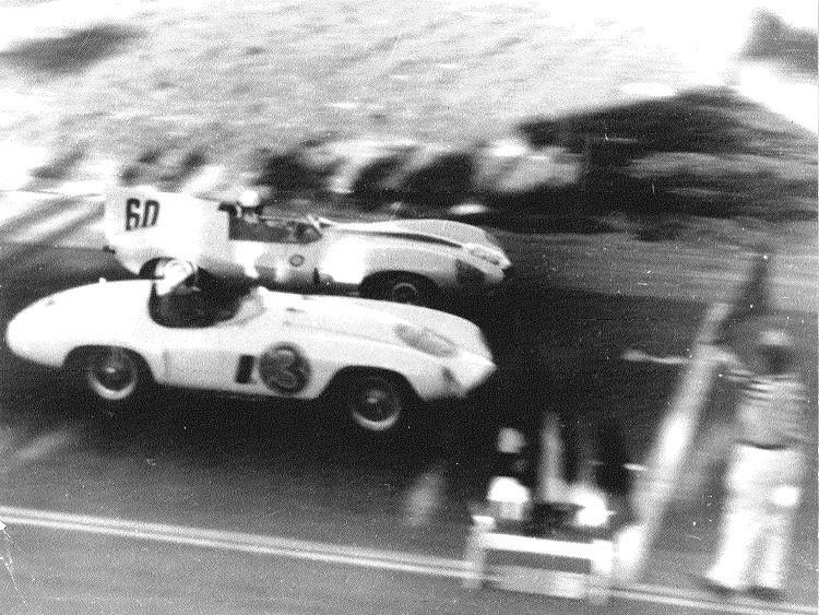 Two racecars finishing the first race in 1955