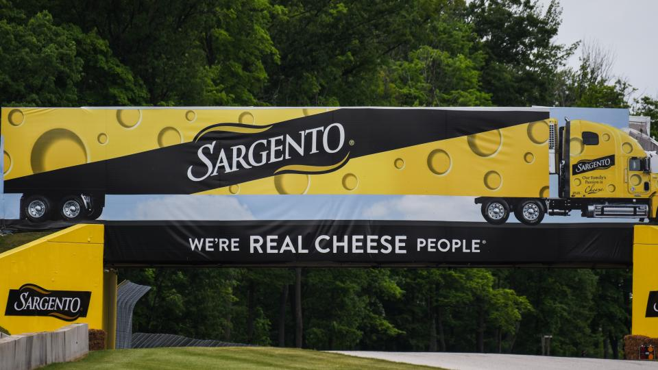 Sargento cheese advertisement banner on the race track