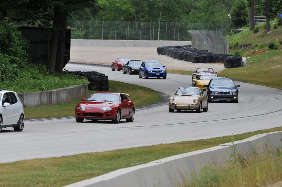 Sports cars driving on a curve on a track